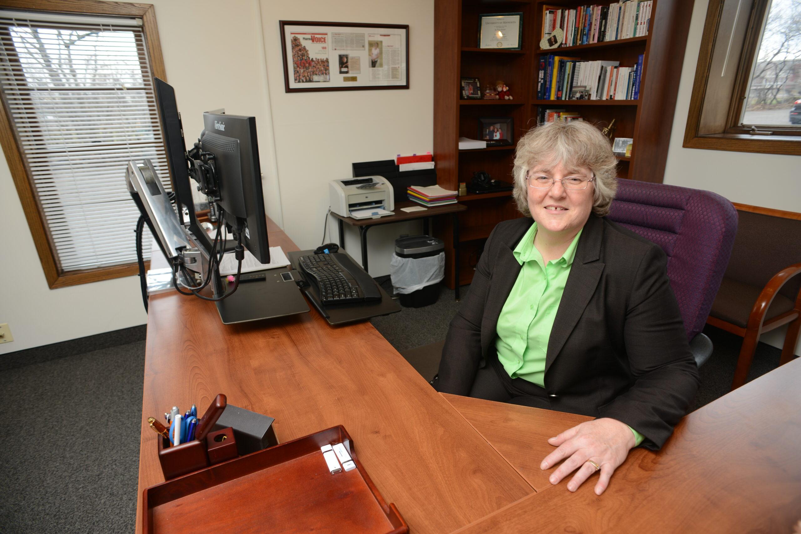 Dr. Joy Frestedt sitting at her office desk